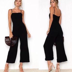 Black zip up one piece.
